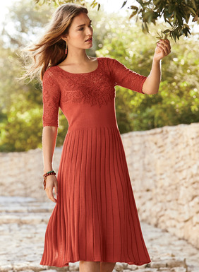 In an irresistible shade of Persimmon pima, the full-fashion knit dress is garlanded in an overlay of handcrocheted flowers at the yoke and elbow-sleeves. Stunning for warm-weather special occasions, it fits through the bodice, releasing at the seamed waist in engineered ribs to a flaring hemline.