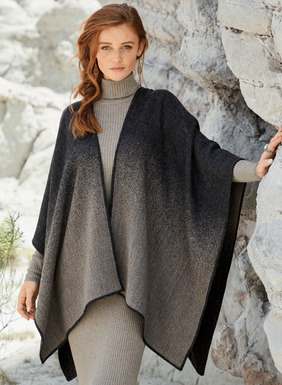 A head-turning layer for cooler days, the ruana is woven in a subtle ombré that shifts from black to taupe, reversing to the opposite on the other side. Exceptionally soft and lightweight in baby alpaca (51%) and acrylic (49%).