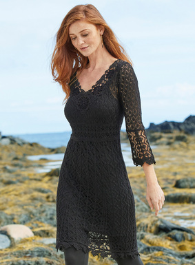 Lit with copper Lurex® (1%) threads, an inlay of handcrocheted medallions graces the deep v-neckline of our lacy black pima (99%) tunic-dress. Superbly engineered in godets for a flattering fit-and-flare shape and detailed with ¾-sleeves, a raised waist and handcrocheted scalloped trim.