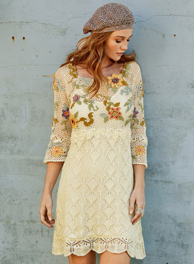 A boho-chic stunner for warm weather occasions, florals climb the handcrocheted netting bodice and sleeves of our pima tunic-dress. In Ivory, accented in dusty shades of amber, peach, pale blue and olive. The fit-and-flare lace shape is hemmed in delicate scallops. Round neckline; belled ¾-sleeves.