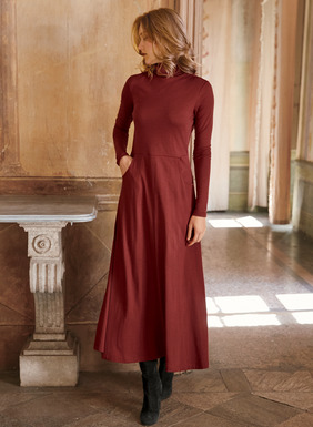 The most versatile dress of the season is this fabulous workhorse for day to evening, work or travel. In soft, drapy pima (51%) and modal (49%) jersey, the spare t-neck dress fits through the double-layered bodice, flowing from a seamed waist to a sweeping boot-length hem; pockets.