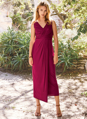 Strategically placed pleating and draping give our curve-flattering column dress a goddess-like appeal. Styled with a crossover v-neck and asymmetrical overlay, the contemporary design is sewn of Hibiscus pima (51%) and modal (49%) jersey.