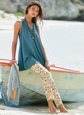 Our breezy trapeze top in pima (51%) and modal (49%) jersey has a v-neck and raw-edged, back-dipping hem.