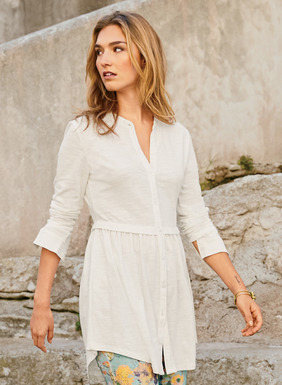 Epitomizing spring's laid-back ease, our kurta-inspired shirt is sewn of slubby cotton jersey flamé, with a band collar and buttoning placket. Gathers at the seamed waist release to a flaring shirttail hem.