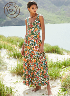 The brilliantly hued floral print jersey maxi-dress beguiles with a fitted bodice and raised waist seam that flows to a triple-tiered hem. Pima (49%), modal (47%) and spandex (4%).