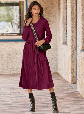 Unser legeres Kleid aus Viskose (95 %) und Elasthan (5 %) hat eine bequeme Passform, geraffte Blousonärmel, eine Taillennaht und einen zweistufigen Rock, der zu einem wadenlagen A-Linien-Saum fällt; Taschen.