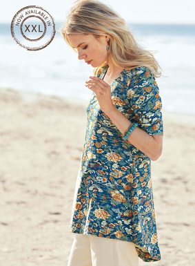 Delicate blooms and butterflies drift across the rich blue ground of our swingy, fit-and-flare tunic. This bestselling shape is sewn of pima (49%), modal (46%) and spandex (5%) jersey. Scoop neck; elbow-sleeves; back-dipping hem.
