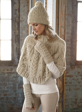 The cozy capelet is exquisitely handknit in chunky cables, twists, ribs and popcorn stitching. Snuggly soft and warm in baby alpaca (70%), poly (23%) and merino wool (7%).