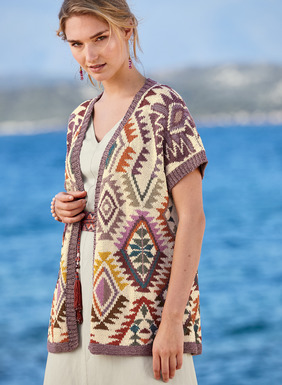 Peruvian geometrics are reimagined in our collectible cardigan in teal, dusty purple, ochre and orange on cream pima. Intarsia knit by hand with drop shoulders, buttonless placket and ribbed trim.