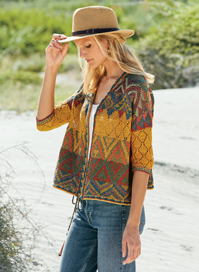 An imaginative canvas of tribal geometrics and openwork lace, our easy, boxy cardigan is knit in sun-drenched hues of amber, jasper, denim, violet and sage pima. The floataway silhouette has drop shoulders, a buttonless placket, elbow-sleeves and contrast pattern trims.