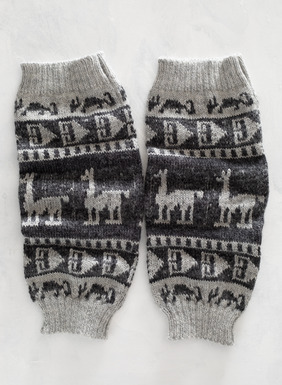 Knit by hand of inca geometrics and alpacas in tweeded charcoal and grey with rib trim.