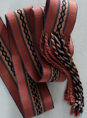 Tie the look together with our artisan-made striped Peruvian pima belt. Completely woven by hand, the sash showcases an array of colorful stripes and patterning in earthy tones and citrus pops, with twisted multicolor fringe tassels.