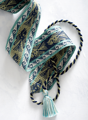 Handwoven by Peruvian artisans in ocean tones of teal, turquoise, blue, green and ivory. Our Peruvian pima cotton belt also features twisted ties, tipped with turquoise and ivory tassels.
