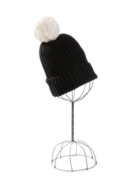 Chunky knit watch cap in black baby alpaca, topped with a white alpaca fur pompom.