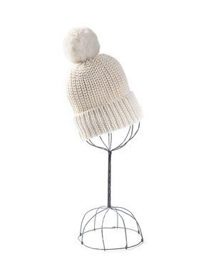 Chunky knit watch cap in black baby alpaca, topped with a white alpaca fur pompom.