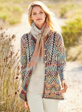 Twice the range in one ingenious design. Knit in a rainbow of exuberant paint-box hues, the intriguing double-face pima cardigan reverses from colorful diamonds on ivory to an ombré of textural pinstripes. Finished with a crewneck and contrast striped trim.