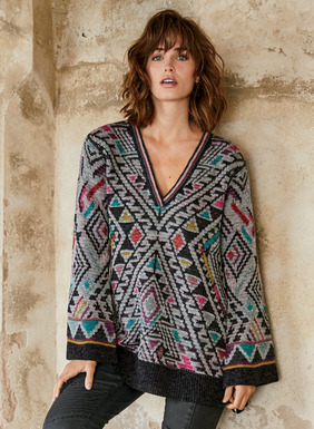 Brightening winter, our whimsical pullover reverses from tattoo geometrics to bands of jewel-toned microstripes on grey and black. Double-faced jacquard knit of baby alpaca (43%), cotton (41%), wool (12%) and nylon (4%). Wide belled sleeves; deep v-neck.
