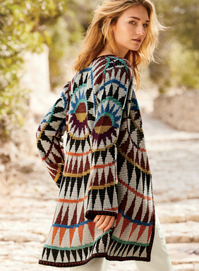 Two sweaters in one and gorgeously graphic in earthen jewel tones mixed with black and sand, our pima cardigan reverses from a bold mandala to bands of richly hued microstripes. A masterful double-face jacquard knit, styled with a single-button closure, bell sleeves and striped trim.