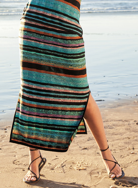 A striking color study, the pima skirt is knit in textural, tweeded stripes of aqua, violet, rose, brandy and black, with side slits. It makes a chic, day-into-evening pairing with the matching tank.