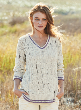 A feminine iteration of a classic cricket sweater, ours showcases a lacy leaf motif. Knit of textural pima (86%) and nylon (14%) bouclé yarns, with a v-neck, contrast striping and relaxed rib trim.