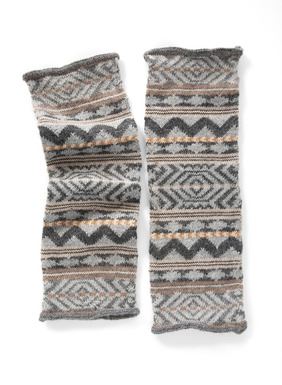Complete your wintry ensemble with the cozy alpaca (92%) legwarmers, patterned with Peruvian geometrics in dusty earth tones and a dash of silver Lurex (8%).