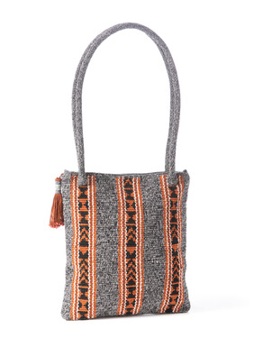 Peruvian manta stripes brighten the mottled grey ground of the handcrocheted pima bag; zip top; shoulder straps; tassel trim.