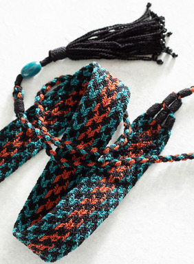 Handcrocheted in Peru by masterful textile artists, this intricate pima cotton belt features a pattern of delicate chevrons in black, paprika, chrysocolla, and tsunami. Braided tassel ties add a chic, bohemian finish. All sales support Peruvian cottage industries working to preserve traditional textile techniques.
