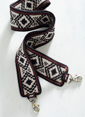 "This detachable strap was handcrocheted in Peru by masterful textile artists. At 37-inches long and 2-inches wide, this sturdy pima cotton accessory features black and cream diamonds lined with brandy and burgundy stripes. Transform your purse into a textile marvel in a matter of seconds. Sales support Peruvian cottage industries preserving traditional textile techniques. <a href=""https://www.peruvianconnection.com/product/s60934-giovanni+bag.do"" target=""_blank"">Giovanni Bag</a> sold separately."