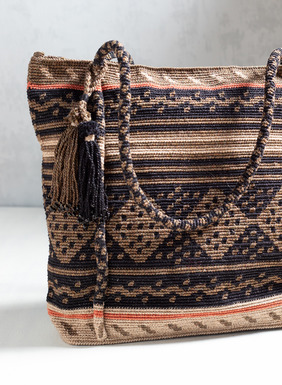 A collectible work of textile art, the bag is artisan-crafted in Peruvian diamonds in black, bronze, stone and coral; zip closure; handles; beaded tassel trim.
