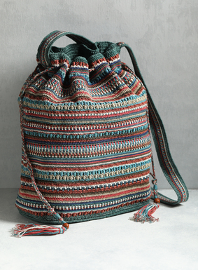 A true work of textile art, our bucket bag is handcrocheted in desert-hued, dimensional bands of Peruvian pima cotton. Shades of cream, coral, orange, spearmint, olive, and dusty blue beckon the season ahead. Complete with drawstring closure, tassel ties, and shoulder strap, our bag is fully lined with a pocket inside.