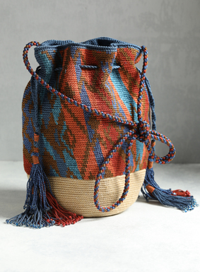 Our stunning Peruvian pima cotton bucket bag is handcrocheted in vibrant stripes and Andean geometrics of yellow, olive, stone, teal, sky, black, and burnt orange. The drawstring closure, braided shoulder strap, and beaded tassel ties offer functional beauty and finesse.