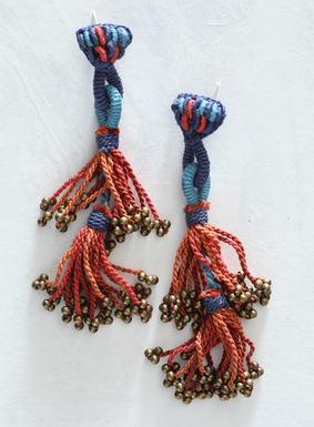 Our artisan crafted, brass-beaded earrings are adorned in tasseled yarns of sky, cerulean and orange Peruvian pima cotton. Bold in color and dramatic in length, these striking earrings are sure to get compliments.