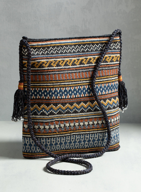 Handcrocheted by Peruvian artisans, this bag is patterned in denim friendly stripes and geometric shapes, with pops of silver and black lurex. A tweeded cord cross body strap and beaded tassels complete our collectible bag.