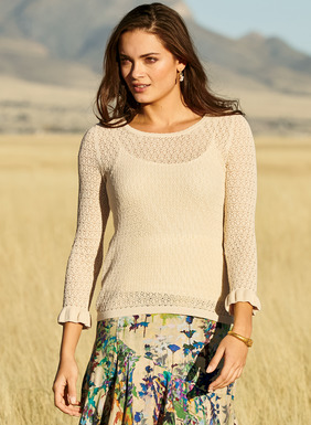 Our lace-knit pima top has a scalloped neckline, ¾-sleeves and ruffled cuffs.