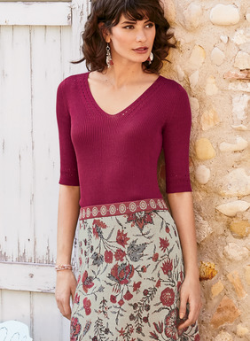 The shapely, elbow-sleeved top is full-fashion knit in engineered ribs of pima and refined with a delicate pointelle trim.