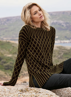 Our graphic take on the iconic fisherman sweater is plaited in black and olive pima and knit in textural diamond cables. Finished with wide contrast ribbing at the yoke, drop shoulders, cuffs and hem. Bateau neck; side vents.