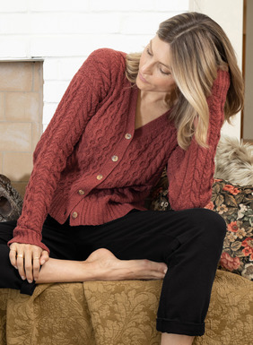 The classic cabled cardigan is knit in a lofty cotton (92%) and nylon (8%) bouclé yarns for year-round comfort. Beautifully fitting, with a v-neck, drop shoulders and chunky ribbed trim.