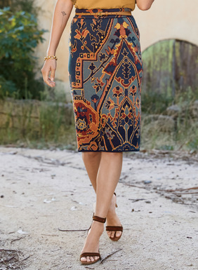 Asymmetrical Persian rug motifs pattern our sleek, shapely pencil skirt. Jacquard knit in chambray, royal blue, gold, tangerine and apricot pima (87%) and Lycra (13%).