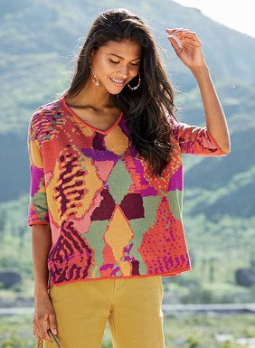 A vintage Moroccan rug is echoed in brilliant fuchsia, amber, coral and sea glass pima. The boxy jacquard  knit top has a v-neck, drop shoulders, slim elbow-sleeves and side slits.