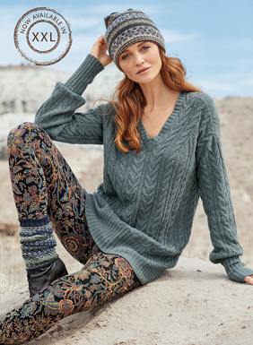 Velvety soft pima (91%) and nylon (9%) bouclé yarns and allover cabling give our pullover its sumptuous texture. Casually relaxed over leggings or skinny jeans, with a deep v-neck, drop shoulders and relaxed rib hem.