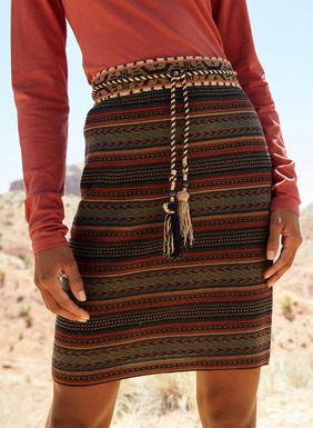 In rich autumnal hues, the pima jacquard knit mini-skirt is banded in pattern-striping inspired by an Indonesian shawl.