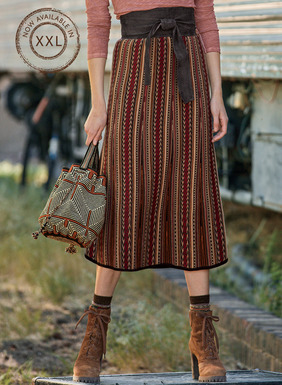 The flaring, boot-length skirt is jacquard knit in geometric patterning from an Indonesian shawl. In autumnal shades of crimson, brandy, tan, gold and black pima.