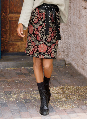 Stylized florals from a 16th century English tapestry pattern the pima jacquard short skirt in rose, cream and taupe on black.