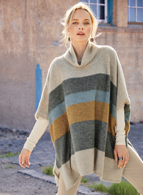 The poncho-inspired pullover is banded with blanket stripes of charcoal, amber and chambray on oatmeal. In warm, softly felted baby alpaca (70%) and wool (30%), with a relaxed t-neck, armholes and deep side vents.