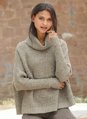 Slim ribbed dolman sleeves balance the volume of this cozy pullover. The poncho-inspired, floataway fit is full-fashion knit in a mélanged barley color of cotton (68%), baby alpaca (19%), nylon (11%) and wool (2%).