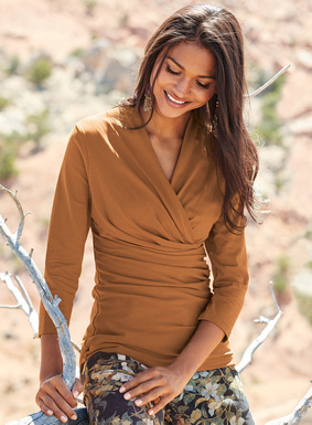 The faux-wrap top is destined to be a year-round staple. Detailed with a v-neckline and flattering waist ruching. Wonderful on its own or under a jacket. In stretchy pima (96%) and spandex (4%) jersey; ¾-sleeves.