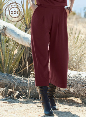The cropped wide-leg jersey trousers create a chic work or travel ensemble. Sewn of drapy viscose (92%) and elastane (8%).
