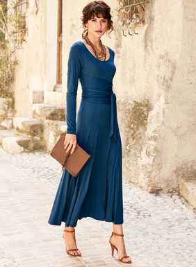Exuding a dancer's grace, the pima (51%) and modal (49%) jersey dress flatters the body in easy gathers from a doubled back layer that wraps and ties in front. Styled with a scoop neck and sweeping, ankle-length hem.