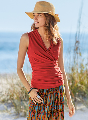Our bestselling faux wrap top, in a sleeveless silhouette for sultry days. Sewn of stretchy pima (96%) and spandex (4%) jersey, with a crossover v-neck and flattering ruching at the waist and hips.