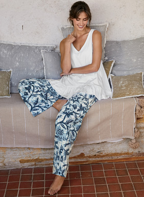 The wide-leg PJ pants of pima cotton jersey feature sky blue and indigo batik botanicals. Elasticized waist; pockets.